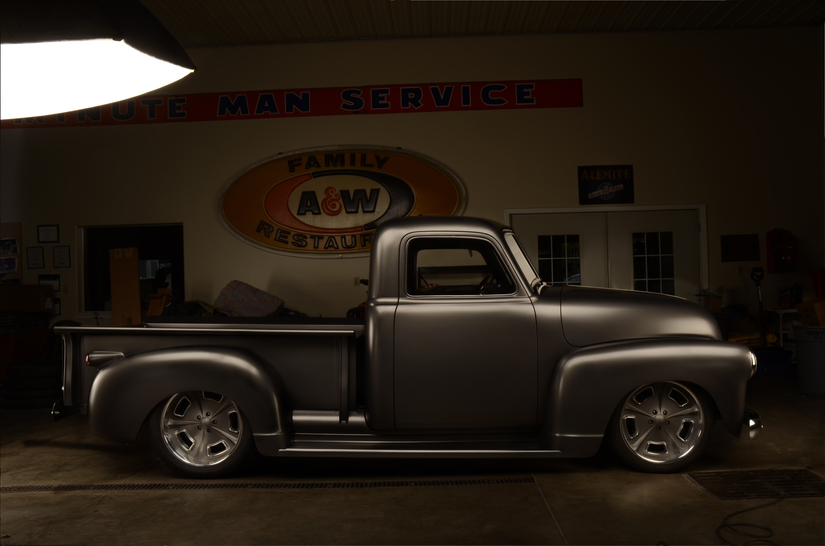 Inside photo shoot of 1949 Chevy Truck with A&W sign at Eddies rod and custom